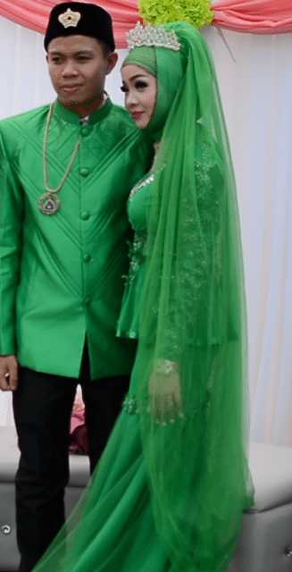 couple dressed up in green